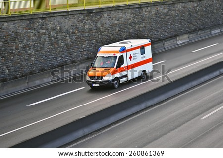 MAINZ, GERMANY - FEB 22: DEUTSCHES ROTES KREUZ van on the highway on February 22, 2015 in Mainz, Germany. The German Red Cross is the National Society of the International Red Cross in Germany. - stock photo