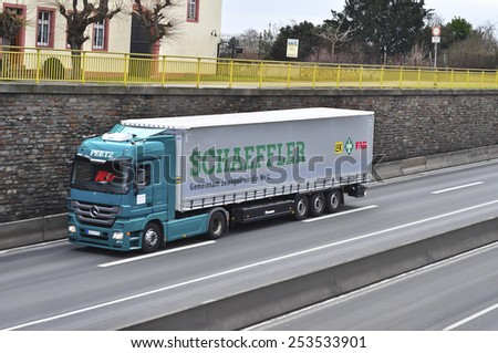 MAINZ,GERMANY-FEB 09: mercedes benz  truck on the highway on February 09,2015 in Mainz,Germany.MB is a German automobile manufacturer, a multinational division of the German manufacturer Daimler AG - stock photo