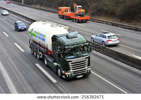 MAINZ,GERMANY-FEB 20:SCANIA truck on the highway on February 20,2015 in Mainz,Germany.Scania, is a major Swedish automotive industry manufacturer of specifically heavy trucks and buses.