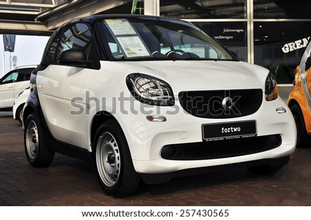 MAINZ,GERMANY-FEB 20:whiteSmart Car on February 20,2015 in Mainz, Germany.Smart Automobile is a division of Daimler AG that manufactures and markets the Smart Fortwo.