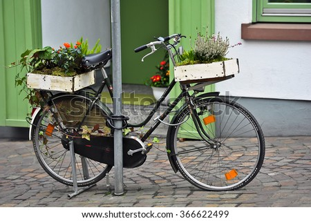 MAINZ,GERMANY-JAN 14:Old bike on the street with flowers on January 14,2016 in Mainz,Germany. - stock photo