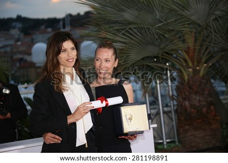 Maiwenn, Emmanuelle Bercot attend a photocall for the winners of the Palm D'Or during the 68th annual Cannes Film Festival on May 24, 2015 in Cannes, France. - stock photo
