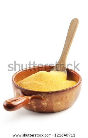 maize flour in a bowl with wooden spoon