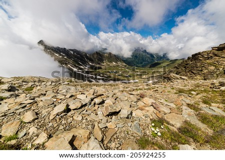 Majestic alpine landscape spotted by blue lakes, once covered by glaciers. - stock photo