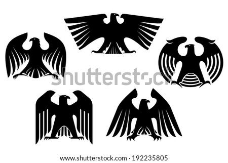 Majestic and powerful heraldic eagles set for tattoo or heraldry logo design. Vector version also available in gallery - stock photo
