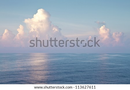 Majestic blue open sea and bright blue cloudy sky landscape with copy space. - stock photo