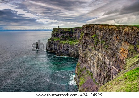 Majestic Cliffs of Moher at the west coast of Ireland - stock photo