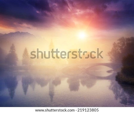 Majestic colorful foggy morning on the lake in Triglav national park, located in the Bohinj Valley of the Julian Alps. Dramatic view of the church St. John the Baptist. Slovenia, Europe. Beauty world. - stock photo