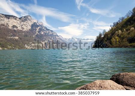 Majestic emerald mountain lake in Switzerland - stock photo