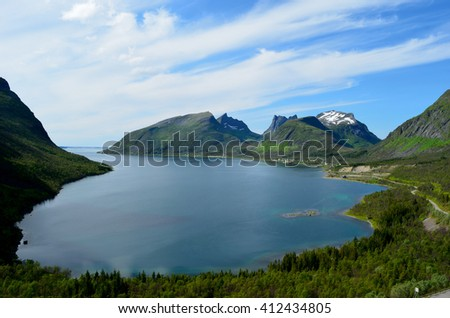 majestic fjord and mountain landscape panorama photo senja island summer - stock photo