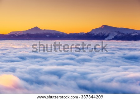 Majestic foggy landscape glowing by sunlight in the morning. Dramatic and picturesque wintry scene. Location Carpathian, Ukraine, Europe. Beauty world. Instagram toning effect. Happy New Year! - stock photo