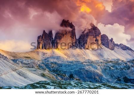 Majestic foggy view of the National Park Tre Cime di Lavaredo with rifugio Locatelli. Dolomites, South Tyrol. Location Auronzo, Italy, Europe. Dramatic scene. Beauty world. - stock photo