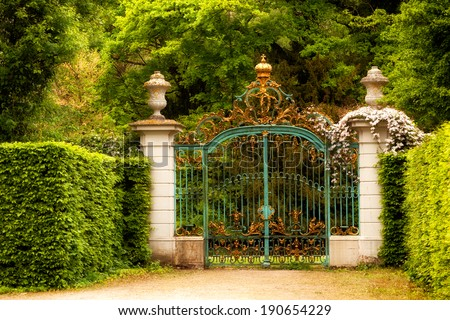 Majestic gate decorated with golden crowns - stock photo