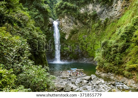 Majestic Hidden Waterfall in Natural Landscape - stock photo