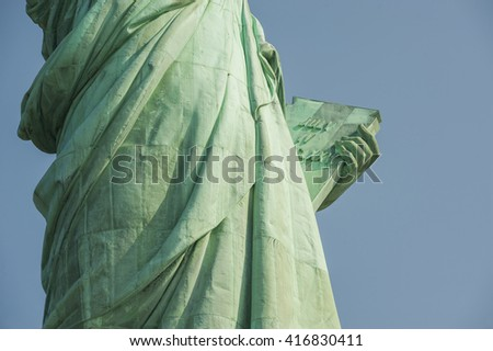 Majestic iconic lady liberty statue of liberty in New York harbor welcoming new arrivals
