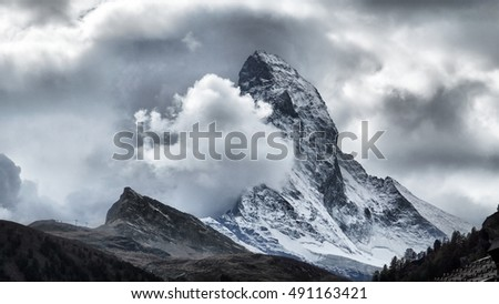 Majestic Matterhorn Mountain in Clouds, the symbol of the Swiss Alps.
