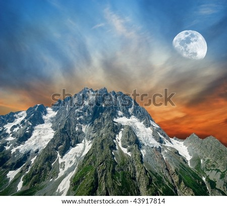 majestic moon above a mountain - stock photo