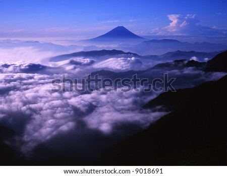 Majestic Mount Fuji rising up through a sea of clouds - stock photo