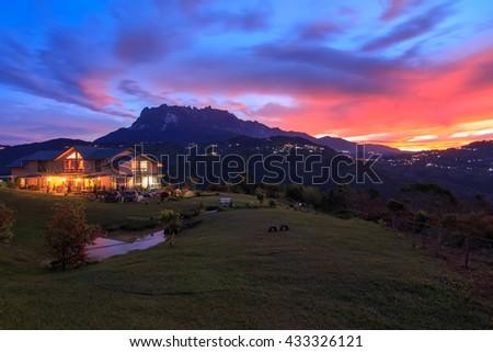 Majestic Mount Kinabalu with beautiful sunrise and amazing sky , The magnificent Mount Kinabalu early morning. - stock photo