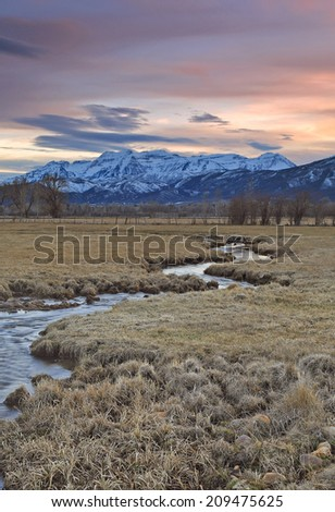 Majestic Mount Timpanogos with a spring sunset, Utah, USA. - stock photo