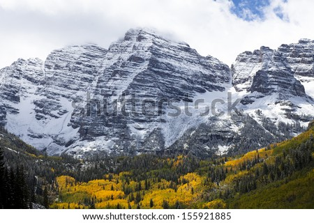 Majestic Mountain and Aspen Grove - stock photo