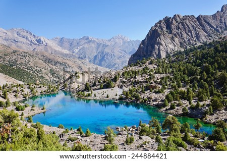 Majestic mountain lake in Tajikistan - stock photo