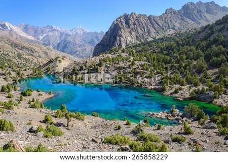 Majestic mountain lake in Tajikistan. - stock photo