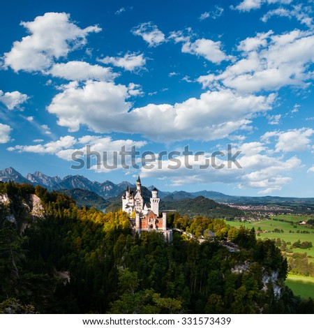 Majestic Neuschwanstein Castle (Bavaria, Germany) with beautiful sky - stock photo