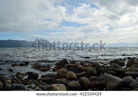 majestic ocean and mountain landscape on the island of Senja, northern Norway in summertime