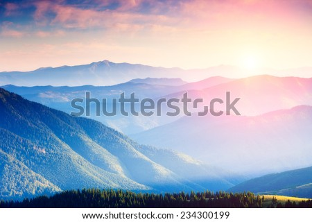 Majestic panorama of green mountains with sunny beams. Dramatic scene. National Park, Carpathian, Ukraine, Europe. Beauty world. - stock photo