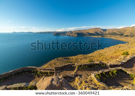 Majestic panoramic view from the top of the mountain in Copacabana, Titicaca Lake, among the most scenic travel destination in Bolivia. Island of the Sun and the Yampupata Peninsula in the distance.