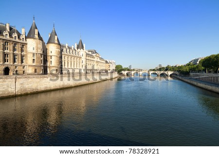 Majestic River Seine in the early morning in Paris, France on a clear blue sky day with classical French architecture. - stock photo