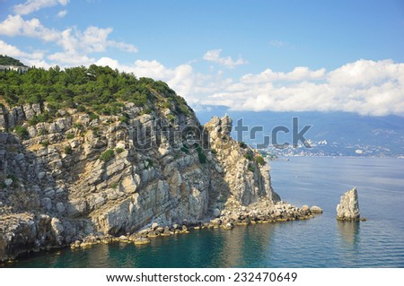 Majestic Rock and a Smaller Rock Resembling a Sailing Ship. - stock photo