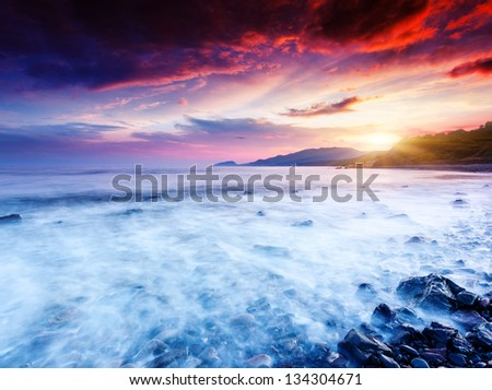 Majestic summer sunset over the sea. Dramatic overcast sky. Crimea, Ukraine, Europe. Beauty world.
