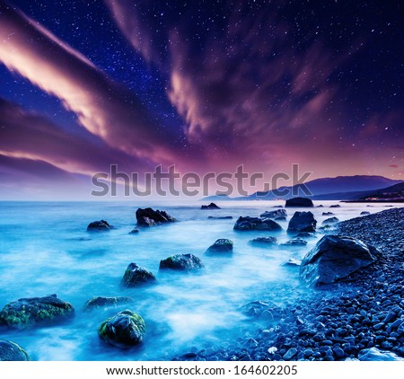 Majestic summer sunset over the sea. Dramatic overcast sky with colorful cloud. Crimea, Ukraine, Europe. Beauty world. - stock photo