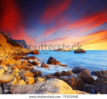 Majestic summer sunset over the sea. Dramatic sky. - stock photo