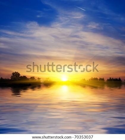 majestic sun rising from a lake panorama - stock photo
