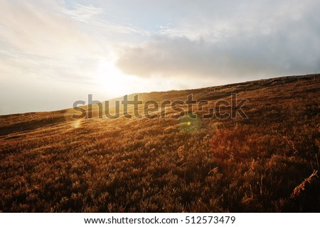 Majestic sunrise at hill in the mountains landscape.