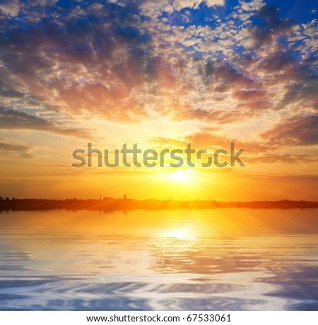 majestic sunrise over a water - stock photo