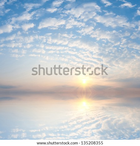 Majestic sunrise over ocean, beautiful clouds in the sky - stock photo