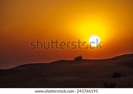 Majestic sunset during the safari in the desert - stock photo