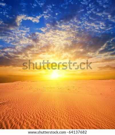 majestic sunset in a desert - stock photo