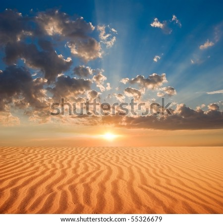 majestic sunset in a sand desert - stock photo