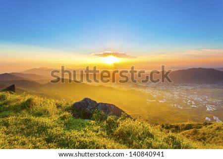 Majestic sunset in mountains, Hong Kong. - stock photo