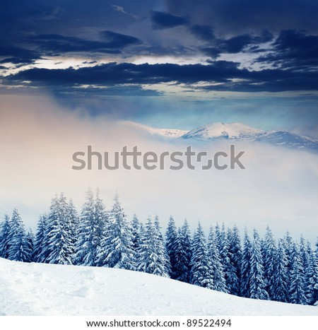 Majestic sunset in the foggy mountains landscape. Dramatic sky. - stock photo
