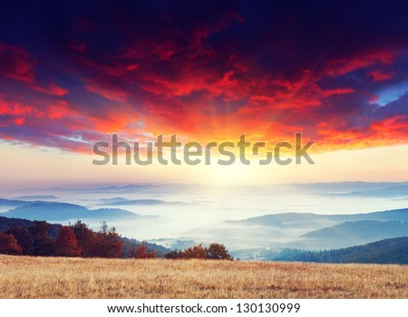 Majestic sunset in the mountains landscape. Overcast sky before storm. Carpathian, Ukraine, Europe. - stock photo