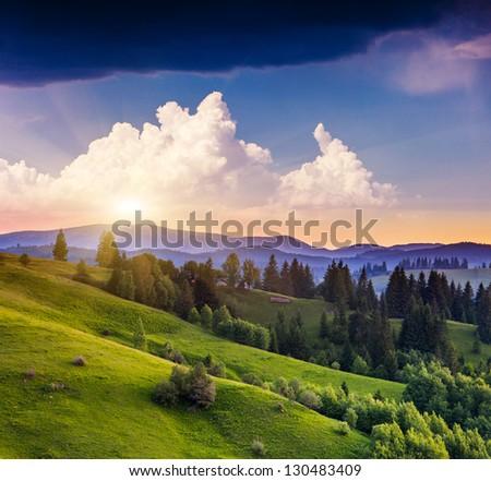 Majestic sunset in the mountains landscape. Overcast sky before storm. Carpathian, Ukraine, Europe. Beauty world. - stock photo
