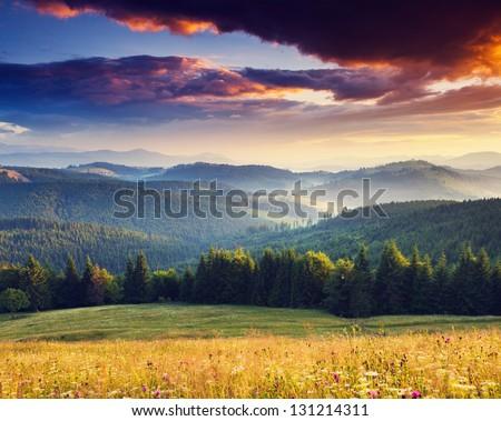 Majestic sunset in the mountains landscape. Overcast sky before storm. Carpathian, Ukraine, Europe. - stock photo