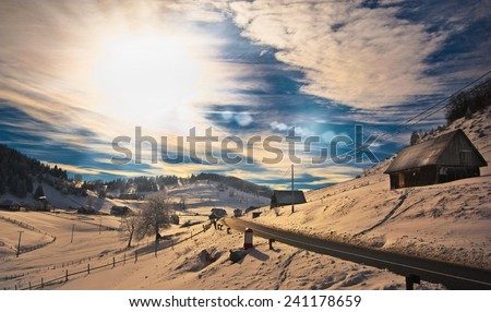 Majestic sunset in the mountains landscape. Sunset landscape in Carpathian mountains. Dawn in mountains Carpathians, Romania. Mountains covered with snow. Mountain road - stock photo