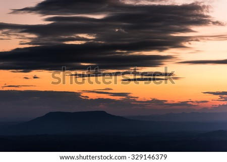 Majestic sunset in the mountains landscape with sunny beams. Dramatic scene